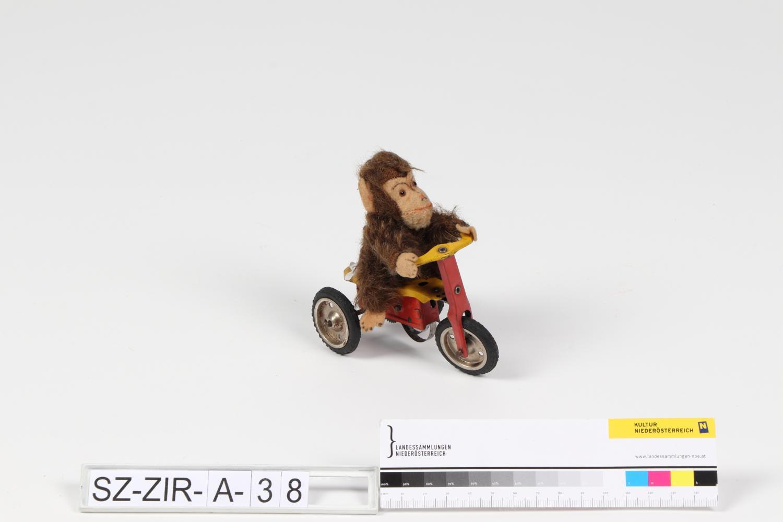 Affe auf Dreirad